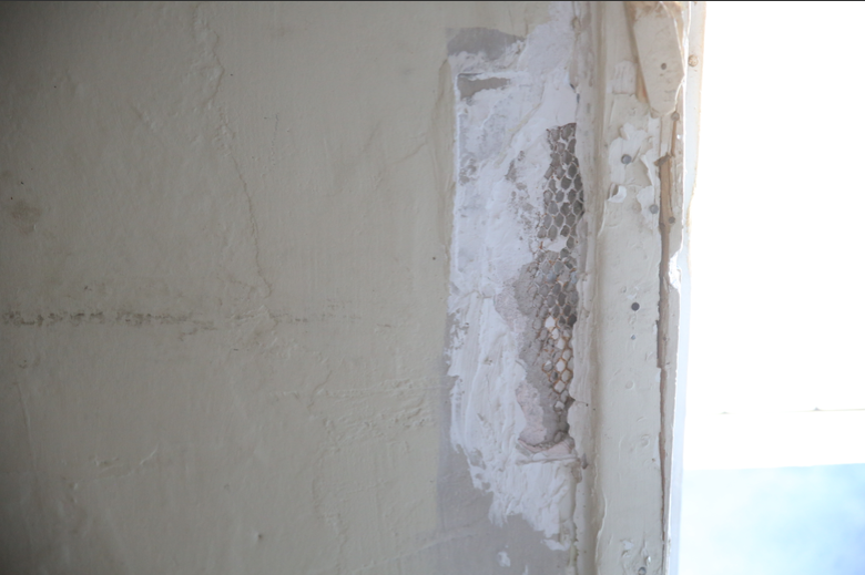A close-up of Joyce McGill's broken doorframe.