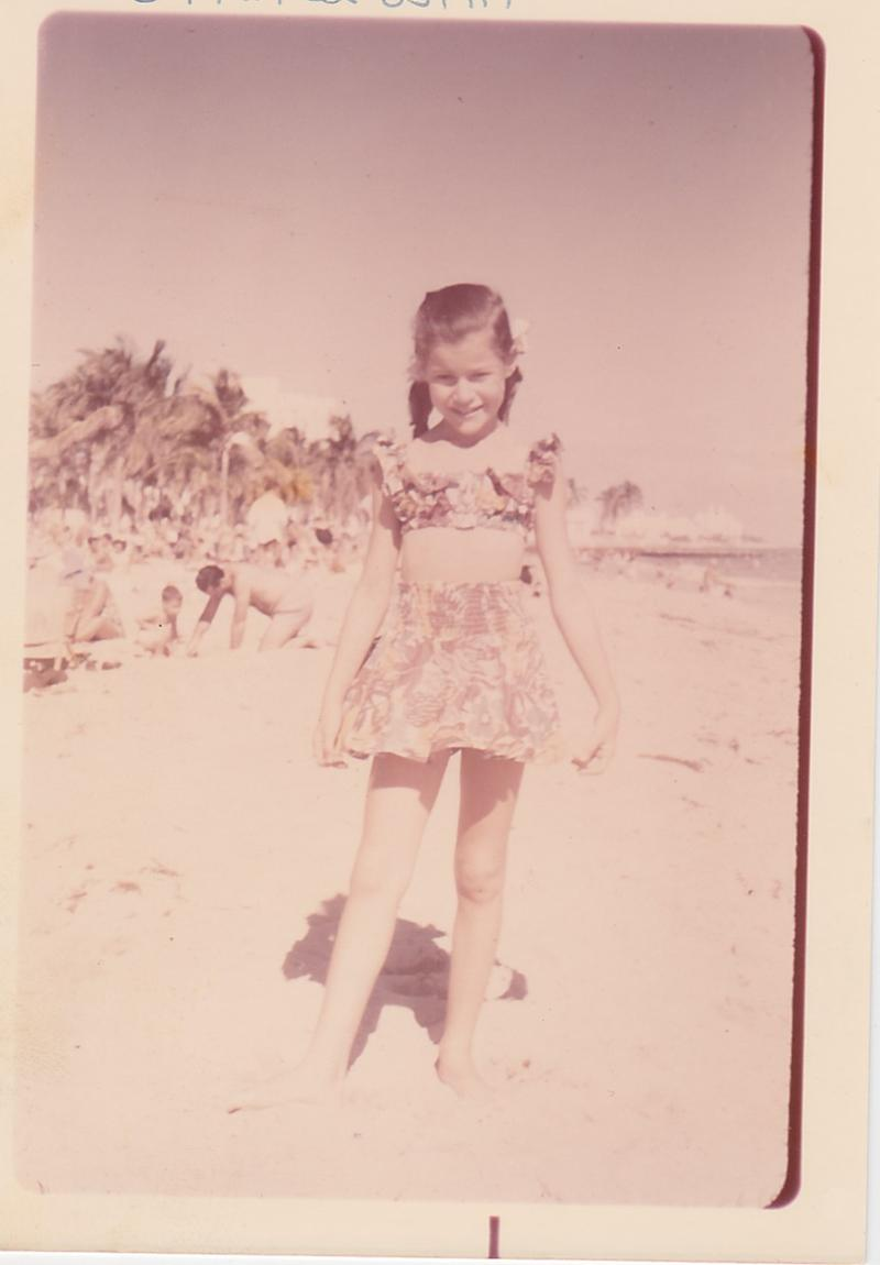 Judy at 9 or 10, showing off her favorite bathing suit on Miami Beach