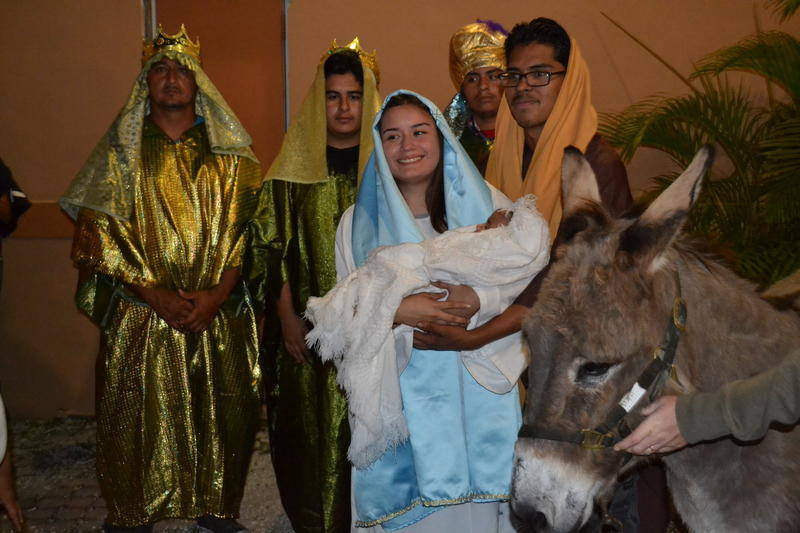 Mexican-Americans in Homestead (and Paco, right) portray Biblical Christmas characters during street processions known as Las Posadas.