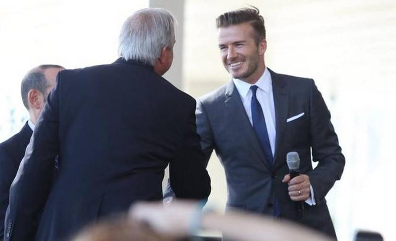 David Beckham greets Miami-Dade Mayor Carlos Gimenez at a news conference in February. Voters will decide the future of the MLS Miami team's stadium in November.