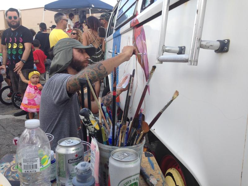 Hialeah artist Ernesto Maranje paints on a VW van at the Leah art district opening.