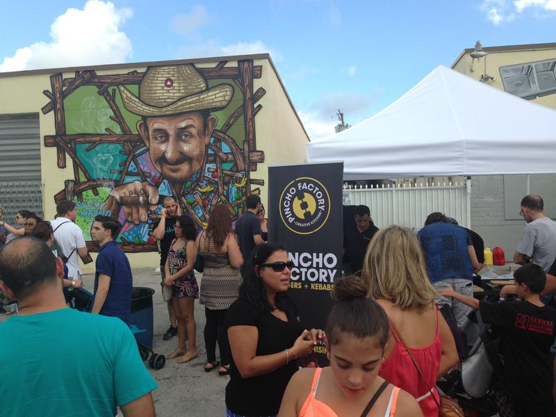 Locals gathered at the opening block party for the Leah art district.