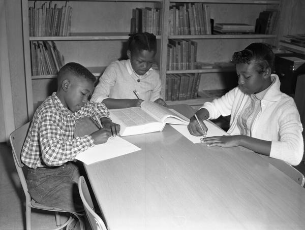African-American children studying in a library in 1960.