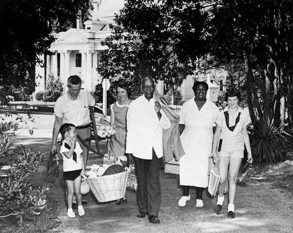 """In 1955, former Governor LeRoy Collins, far left, moving from the prior Governor's Mansion to his new home, """"The Grove."""""""