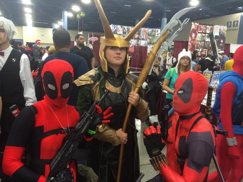 (Left to right) Alicia Drumheller, Erica Partlow, and Reynaldo Rivera are dressed as the Marvel comics characters Deadpool and Loki.