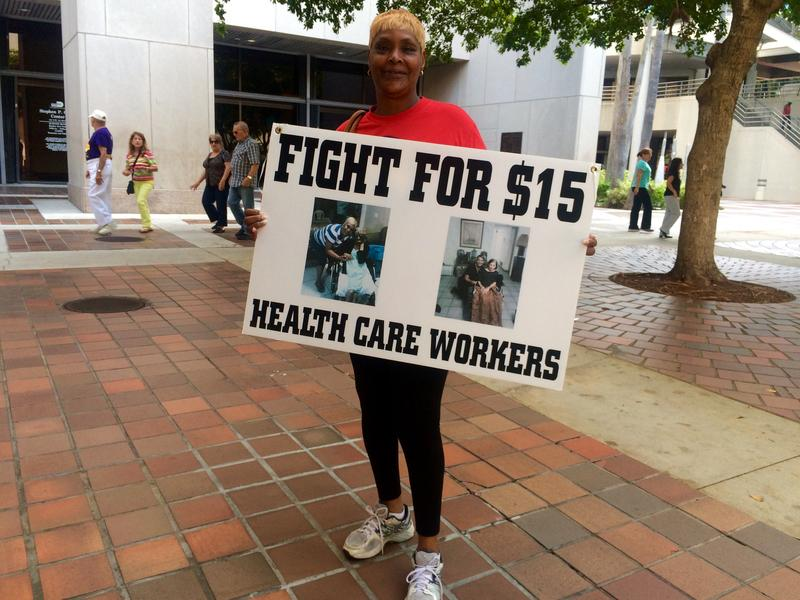 Molita Cunningham, a nurse at a hospice, calls for a $15 minimum wage at a conference Thursday.