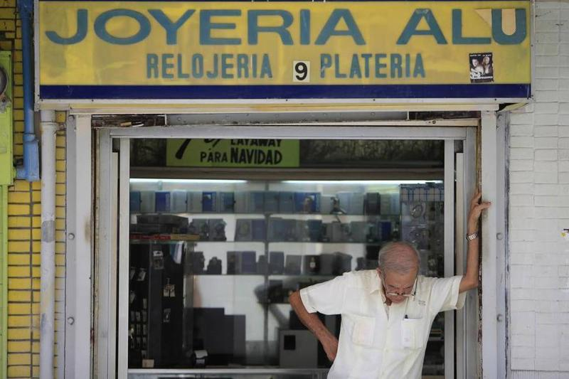 A jewelry store owner in San Juan, Puerto Rico, ponders the island's economic emergency.