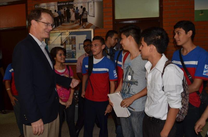 U.S. Ambassador to Honduras James Nealon talks with Honduran teens at a cultural center in the gang-ravaged city of San Pedro Sula