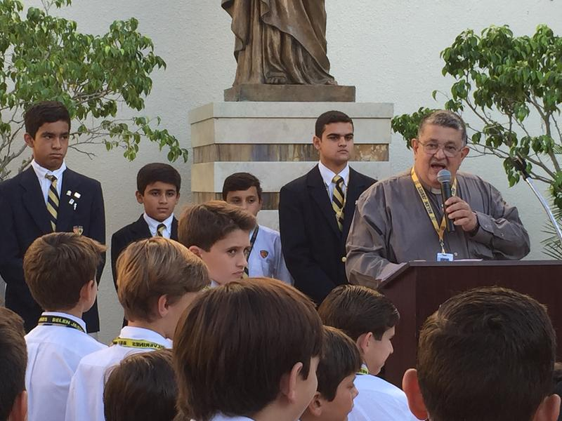 Father Pedro Suarez leads a blessing of Belen Jesuit students, parents and community members who plan to attend papal events in the U.S. or Cuba.