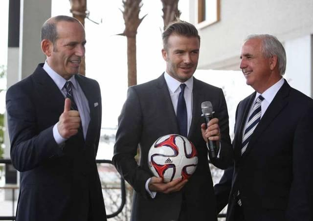 After five years, David Beckham, center, is moving ahead with a MLS team in Miami. But plans to build a stadium in Overtown has some residents worried.