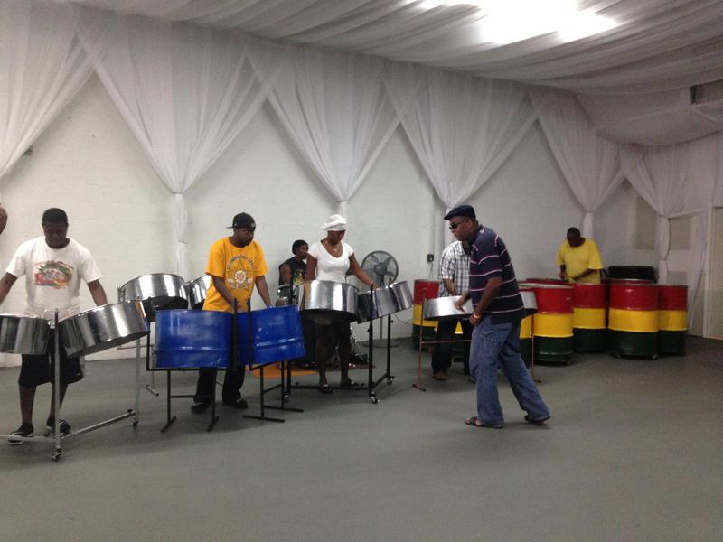 "Henry Potter directing Tamboo Bamboo as they rehearse for the annual ""Panorama"" steel band competition before the Miami Broward Carnival."