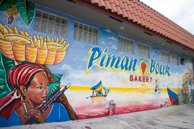 Artist Serge Toussaint painted the Piman Bouk bakery in Little Haiti. His utilitarian murals have decorated the neighborhood since the '90s.