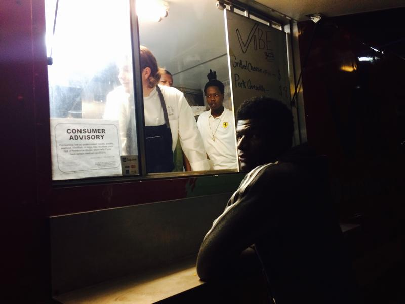 Brad Kilgore in the truck talks with the young guys who work at the Vibe 305 food truck.
