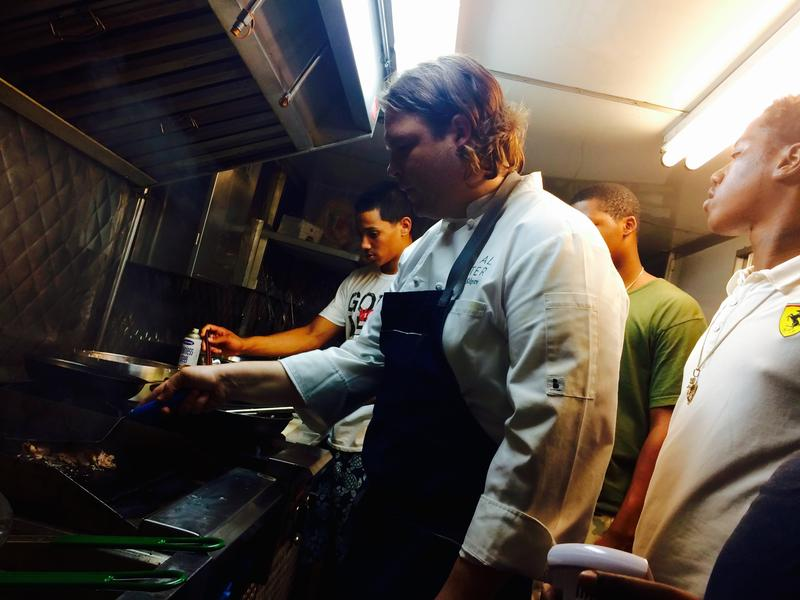 The guys of Vibe 305 get some tips from chef Brad Kilgore, center.