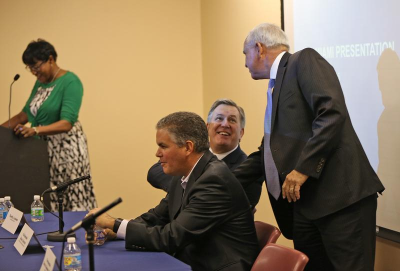 Timothy Leiweke of Miami Beckham United shakes hands with Miami-Dade Mayor Carlos Gimenez as the David Beckham group and Miami-Dade officials held a town hall meeting on plans for a stadium in Overtown on Thursday December 17, 2015.