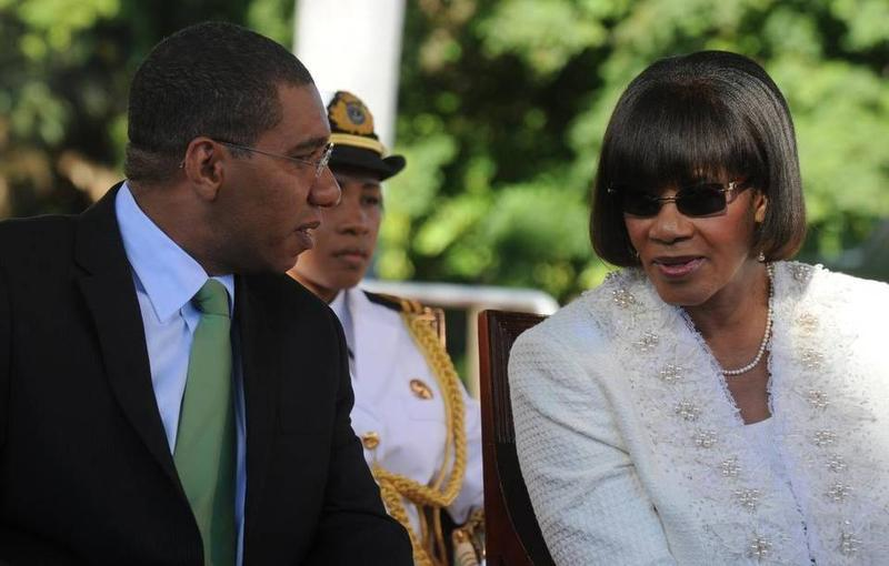 Jamaican Prime Minister-elect Andrew Holness (left) and outgoing PM Portia Simpson-Miller in a 2012 photo.