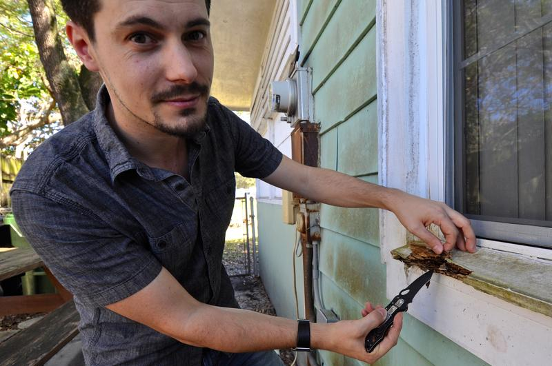 UF termite researcher Thomas Chouvenc pokes at a home's window sill eaten by termites in a Ft. Lauderdale neighborhood.
