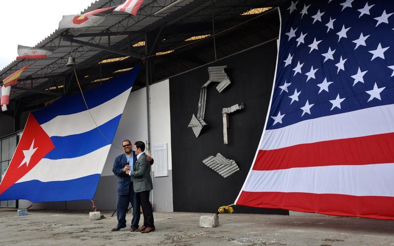 Cuban sculptor Kcho (left) and Google's Brett Perlmutter at last week's opening of Google's tech center at Kcho's Havana studio.