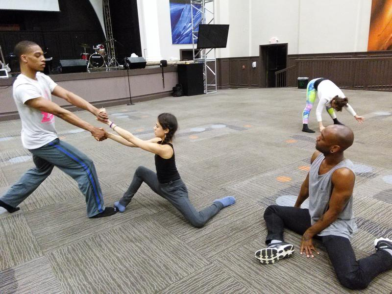 Zest Collective founder Gentry George, right, looks on as dancers rehearse.