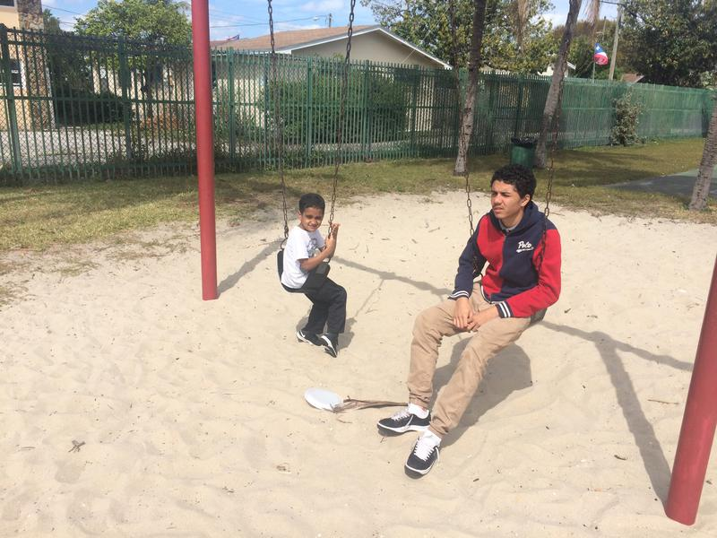 Wanda Gomez's sons bide their time at a park in Wynwood while their mother works nearby