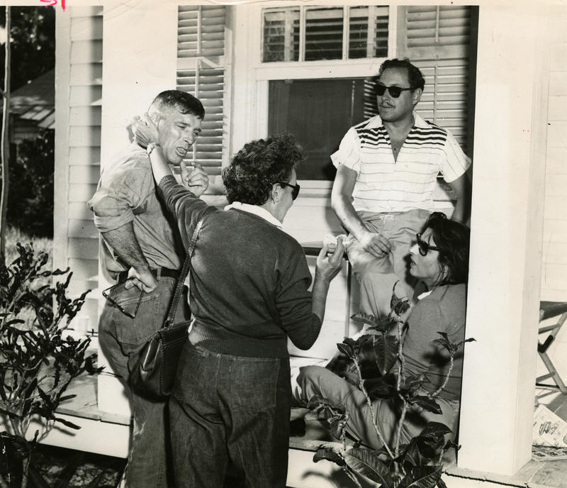 Burt Lancaster, Anna Magnani's secretary, Tennessee Williams and Magnani on the porch of the Key West home known as 'The Rose Tattoo House.'