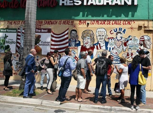 Visiting Cuban artists take in mural art in Little Havana this week.