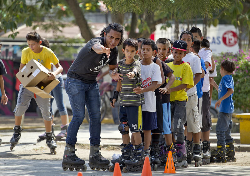 Jessel Recinos teaches children to skate in Cofradía Park in San Pedro Sula, Honduras. Recinos runs a club called Skate Brothers, which teaches kids to skateboard, rollerblade and stay clear of the dangerous street gangs.