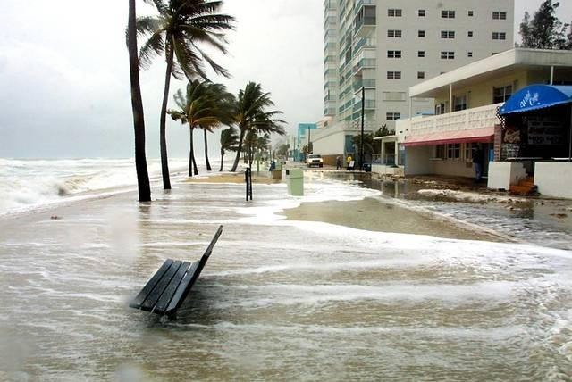 As erosion takes its toll on South Florida beaches, the surf swirls around a wood bench just a few yards from the Hollywood Broadwalk between New York and Taylor streets in this file photo.