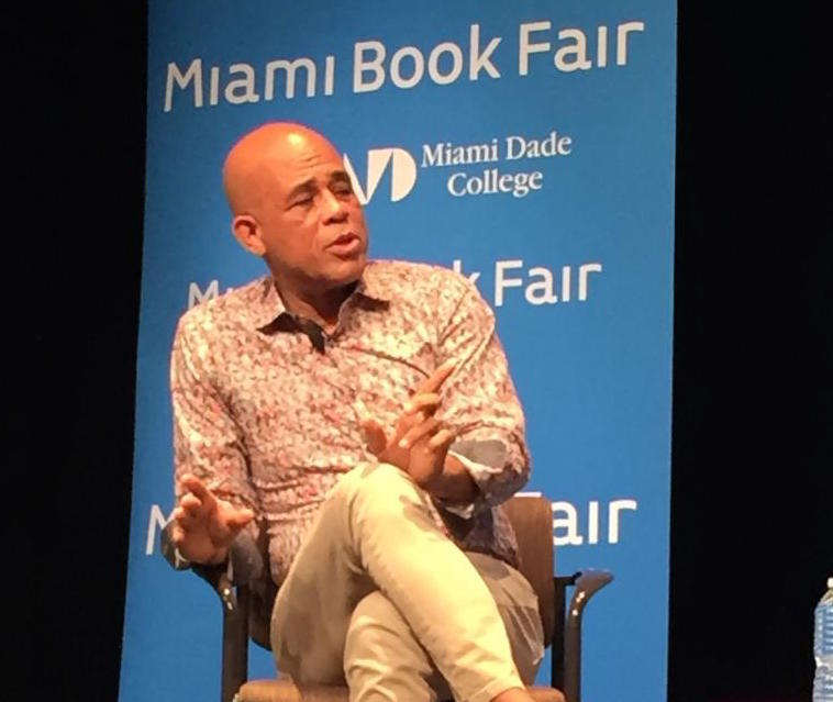 Former Haitian President Michel Martelly discusses his new autobiography at Miami-Dade College Wednesday night.