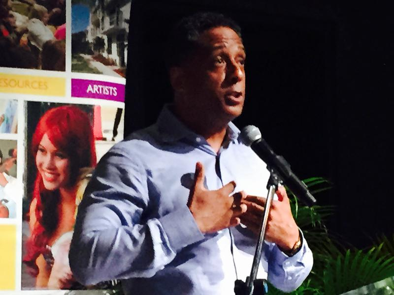 Hugo Cancio speaking at the Orange Economy symposium last Friday at Broward College.