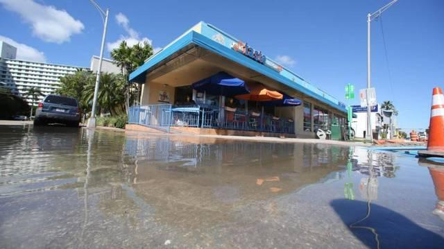 Miami Beach officials installed massive pumps to address flooding, pictured here at Flooded Alton Road Ninth Street. But scientists now say pumping stormwater is dumping water laced with high amounts of human waste into the bay.