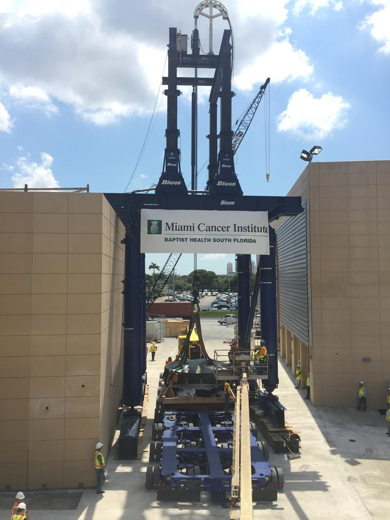 "On Tuesday, June 14, 2016 ""Proton Pete,"" is carried into Baptist Health by a crane."