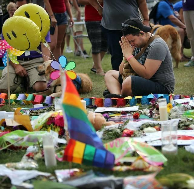 Edwin Lopez mourns for twelve friends that he lost in the Pulse nightclub shooting. Lopez was at the growing memorial at the Dr. Phillips Center for the Performing Arts, on Tuesday, June 14, 2016.