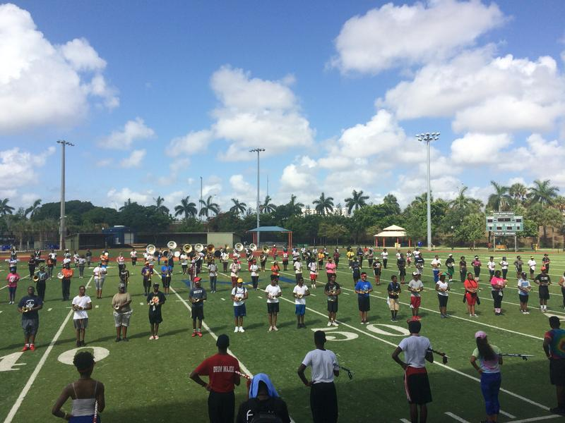 South Florida Marching Band Precision Camp: loud, disciplined, and fun enough to get teenagers to spend the day dancing in 90 degree heat with tubas on their backs.