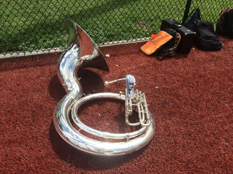 Instruments filled the track while students took a water break