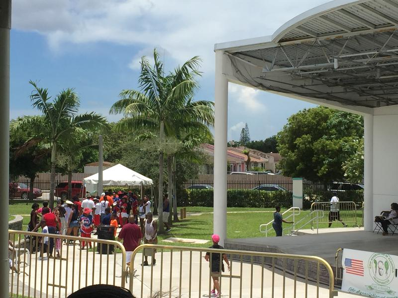 People celebrating the Fourth of July with the Edo Association line up for lunch ahead of the afternoon's activities.