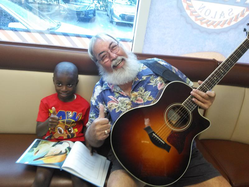 Mikkael Stevens practiced his ABCs with author Darrell House.