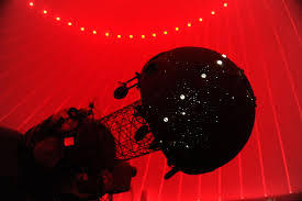 A Spitz A-1 Star Projector scans the skies in the Frost Science, now closed, planetarium.