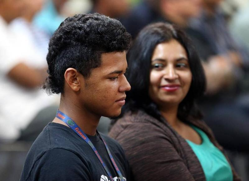 A Honduran teenager named Daniel attends a North Lauderdale church service with his mother after recently arriving in the U.S. escaping gang violence.