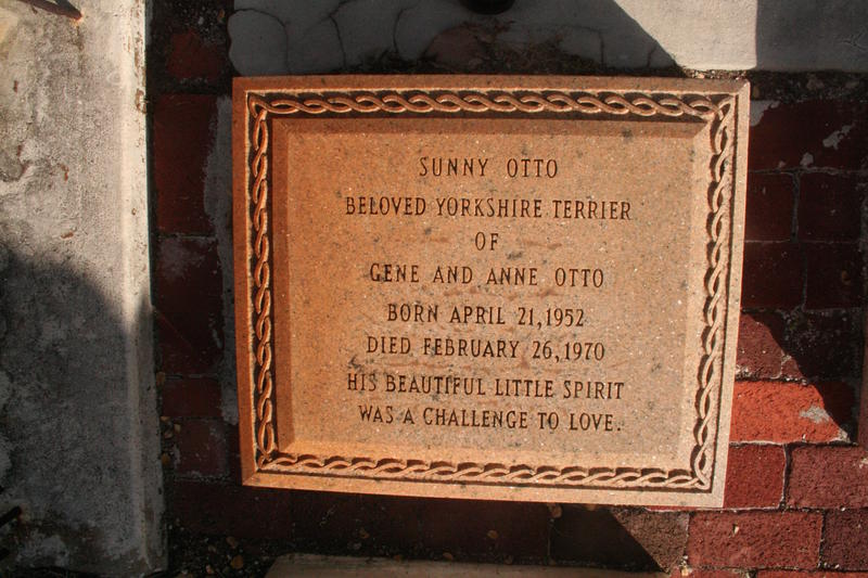 "The Otto family plot includes three markers for Yorkshire terriers — including this one for a dog whose ""beautiful little spirit was a challenge to love."""