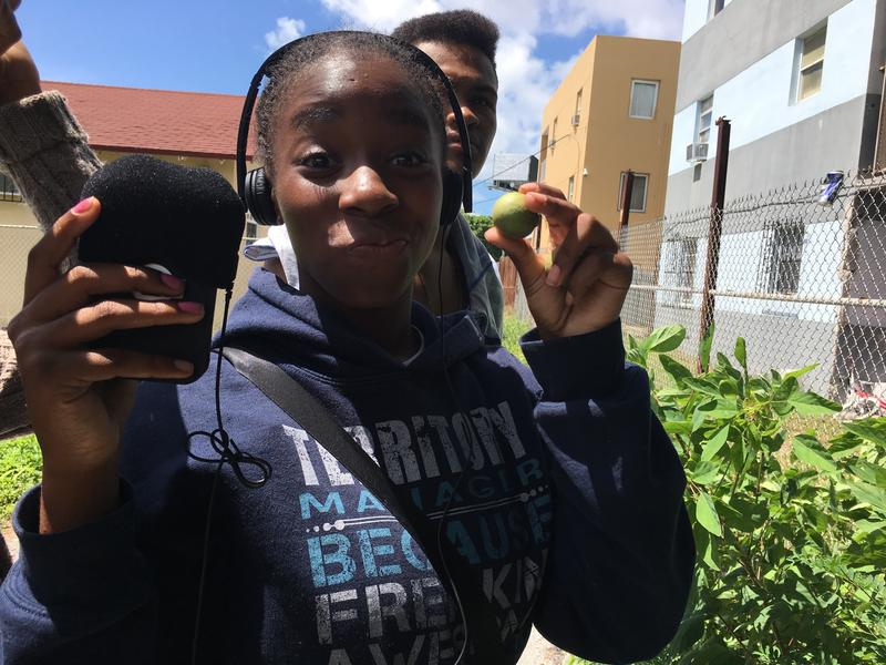 Rochnel Jean-Baptiste showing off her Spanish lime.