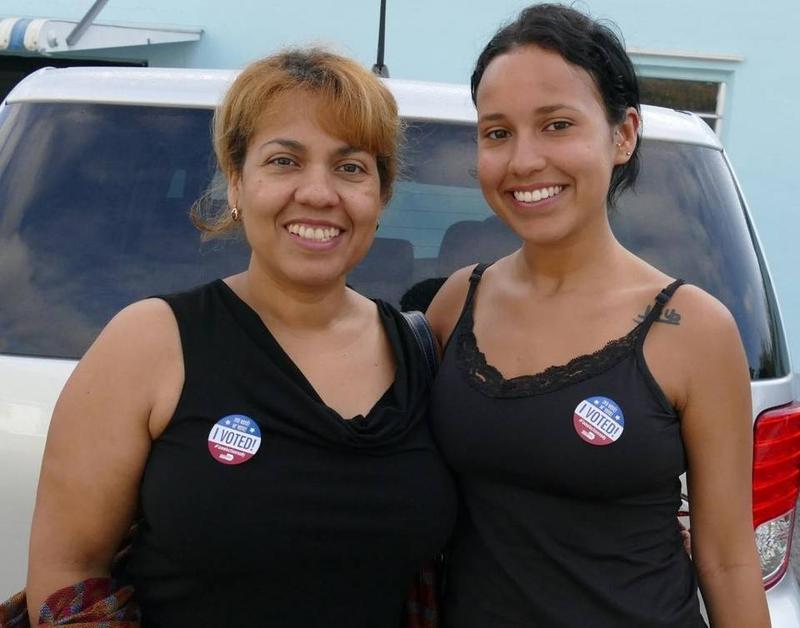 Florida Latinas Maria Lozano (left) and Gabriella Genao vote for Hillary Clinton during the primary election in March.