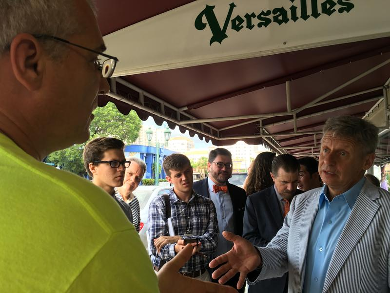 Presidential candidate Gary Johnson talking to voters at Versailles restaurant