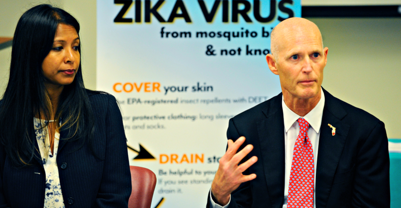 Florida Gov. Rick Scott (right) with state Surgeon General Celeste Philip during a press conference about Zika on June 9, 2016.