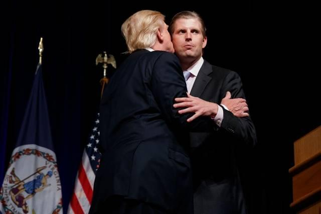 Eric Trump gets a kiss from dad, presidential candidate Donald Trump, during a campaign rally at Briar Woods High School on Aug. 2, 2016, in Ashburn, Va.
