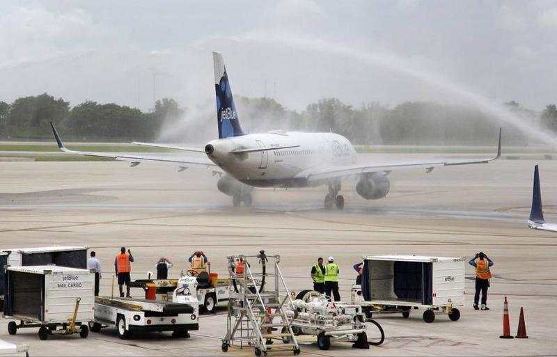The JetBlue flight from Fort Lauderdale gets a water-cannon salute as it arrives in Santa Clara, Cuba, last week.
