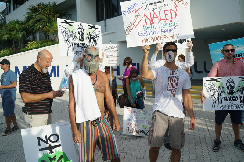 "Anti-naled protesters chanted, ""If you're gonna spray, we want a say!"" outside the Miami Beach City Center on Wednesday."