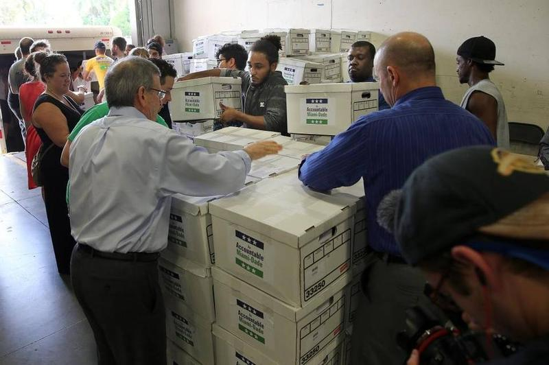 More than 127,000 petitions in favor of a ballot initiative on campaign finance reform were delivered to the Board of Elections in August