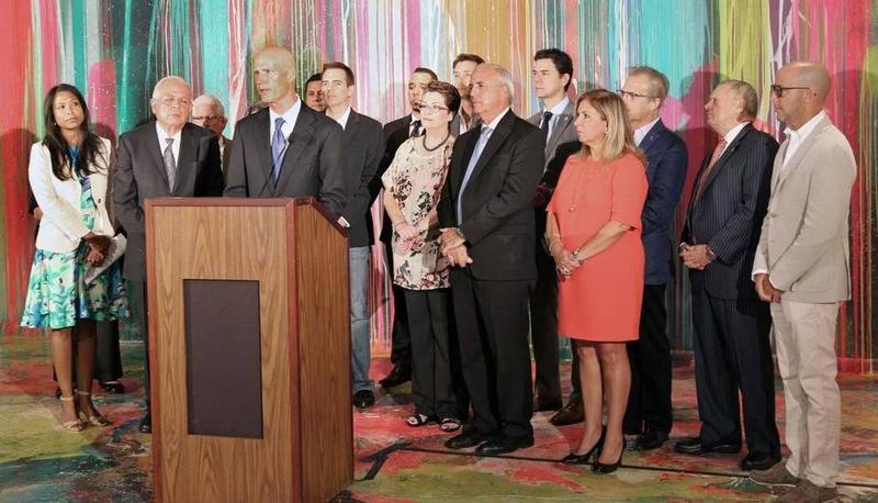 Florida Gov. Rick Scott speaks at a press conference in Wynwood, surrounded by other state and local officials, including state Surgeon General Celeste Philip, Miami-Dade County Mayor Carlos Giménez and City of Miami Mayor Tomás Regalado.