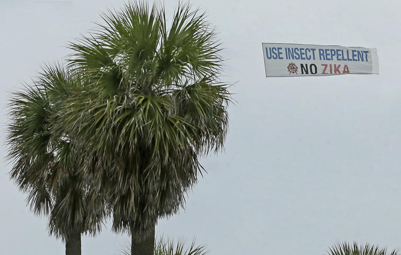 An aerial banner is flown over the South Pointe Park area, Tuesday, Sept. 6, 2016, in Miami Beach, Fla. Aerial spraying of the insecticide naled is scheduled over South Beach, where more mosquitoes have tested positive for the Zika virus.